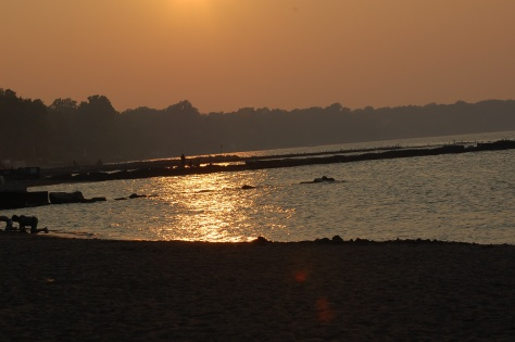 Sunset over water. Photograph taken and copyrighted by Barbara Mattio 2013