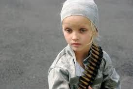 This little one is a child soldier. Young, yes. Willing, no.