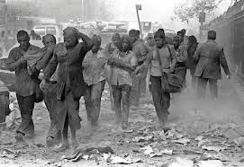 People running from the collapsed towers