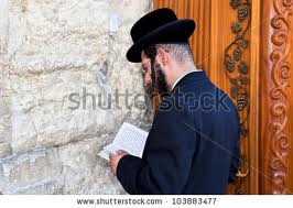 Jews pray at the wailing wall for peace, kindness and for their families