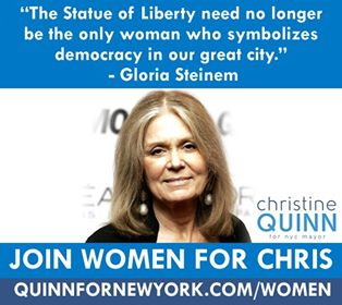 Gloria Steinem makes point with Statue of Liberty.