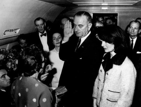 Johnson taking oath of office on Air Force One