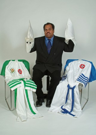 KKK DD-With-Robes-Hoods-Given-to-Him-by-Klan-Members-321x450
