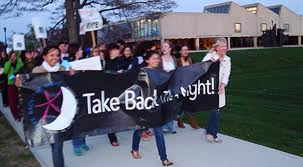 Young women marching to :take back the night: