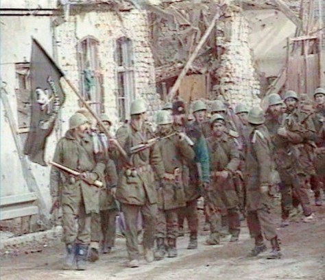 "Vukovar, Croatia 1991 Serb Chetnik and Serb-led Yugoslav army march into Vukovar singing: ""Slobo, Slobo (as in Slobodan Milosevic) send us some salad, there will be meat, we'll slaughter the Croats"" (BBC newsreel screenshot)"