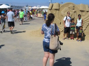People arrive at the 2014 US Sand Sculpting Challenge and 3D Art Expo in San Diego.