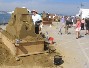 Teams create fantastic sand sculptures out toward the end of the pier.