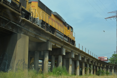 yellow train on a bridge