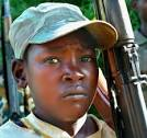 A child soldier who looks terrified.