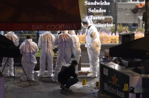 Forensic experts inspect the site of an attack, a restaurant outside the Stade de France stadium in Saint-Denis, north of Paris, late on November 13, 2015, after a series of gun attacks occurred across Paris as well as explosions outside the national stadium where France was hosting Germany. A number of people were killed and others injured in a series of gun attacks across Paris, as well as explosions outside the national stadium where France was hosting Germany. AFP PHOTO / FRANCK FIFE