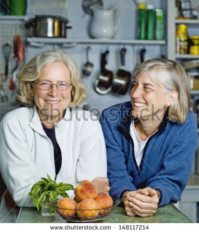 stock-photo-smiling-senior-women-leaning-at-kitchen-counter-148117214