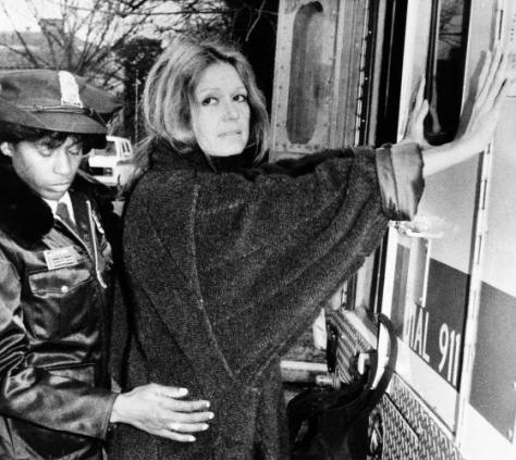 A uniformed officer arrests feminist Gloria Steinem during an anti-apartheid protest outside the South African Embassy in Washington, Dec. 19, 1984. (AP Photo/Pool)
