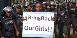 A young man demonstrates for the return of the girls. We must all our voices. These young women and girls are voiceless!