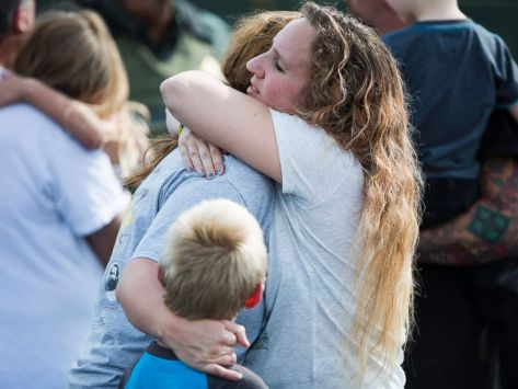 Korrie Bennett hugs Heather Bailey after recovering their children following a shooting at Townville Elementary in Townville, Sept. 28, 2016.