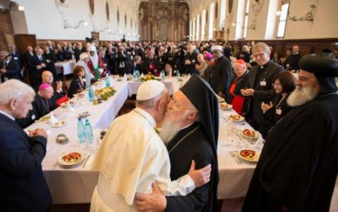 "Pope Francis (L) hugs Ecumenical Patriarch Bartholomew I (R) during the inter-religious meeting ""Prayer for Peace"" in Assisi, Italy, September 20, 2016. Osservatore Romano/Handout via Reuters"