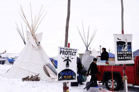"People donate food and equipment to campers inside of the Oceti Sakowin camp as ""water protectors"" continue to demonstrate against plans to pass the Dakota Access pipeline near the Standing Rock Indian Reservation, near Cannon Ball, North Dakota, U.S., December 2, 2016. REUTERS/Lucas Jackson"