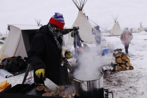 "Campers cook lunch inside of the Oceti Sakowin camp as ""water protectors"" continue to demonstrate against plans to pass the Dakota Access pipeline near the Standing Rock Indian Reservation, near Cannon Ball, North Dakota, U.S., December 2, 2016. REUTERS/Lucas Jackson"