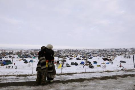 "Demonstrators greet each other near the entrance of the Oceti Sakowin camp as ""water protectors"" continue demonstrations against plans to pass the Dakota Access pipeline continue near the Standing Rock Indian Reservation, near Cannon Ball, North Dakota, U.S., December 2, 2016. REUTERS/Lucas Jackson"