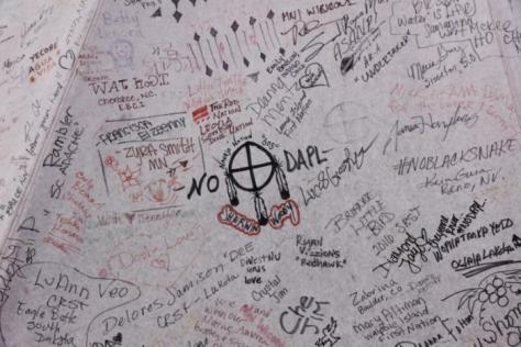"Messages of support adorn the side of a tipi inside of the Oceti Sakowin camp as ""water protectors"" continue to demonstrate against plans to pass the Dakota Access pipeline near the Standing Rock Indian Reservation, near Cannon Ball, North Dakota, U.S., December 2, 2016. REUTERS/Lucas Jackson"