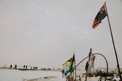 "A group walks towards the entrance of the Oceti Sakowin camp as ""water protectors"" continue demonstrations against plans to pass the Dakota Access pipeline near the Standing Rock Indian Reservation, near Cannon Ball, North Dakota, U.S., December 2, 2016. REUTERS/Lucas Jackson"