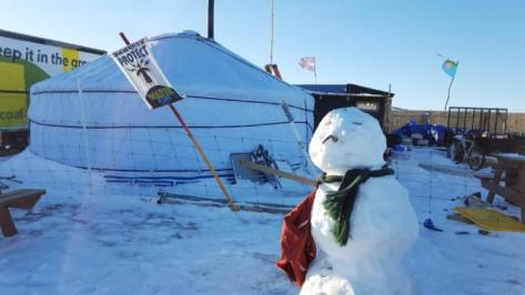 A snowman stands as the remaining activists are grappling with plunging temperatures that make conditions more difficult at the protest camp in Cannon Ball, North Dakota, December 14, 2016. Picture taken December 14, 2016. REUTERS/Valerie Volcovici