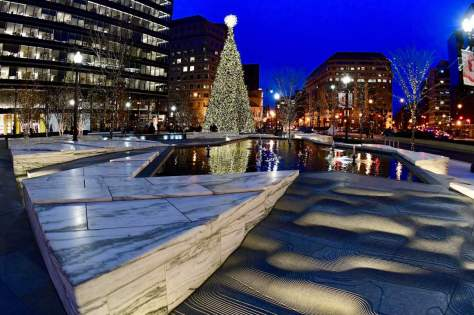 People look at a Christmas tree at CityCenterDC in downtown Washington on December 04. Getty