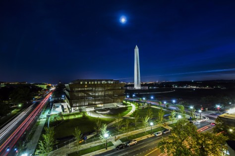 From the top of the Department of Commerce building looking south across Constitution Avenue NW, the NMAAHC sits between 14th Street, left, and 15th Street, right, near the Washington Monument. Getty