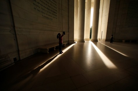 A visitor to the Jefferson Memorial casts a long shadow as she holds up her tablet to take a photo on October 12. REUTERS
