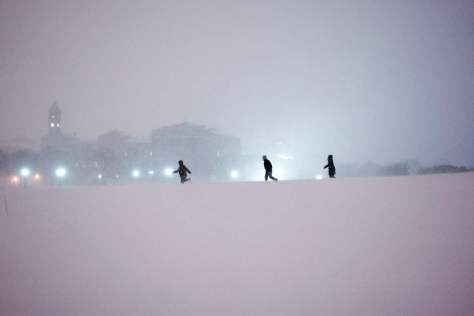 Children play in the snow on the National Mall after a snowstorm on January 23. Getty